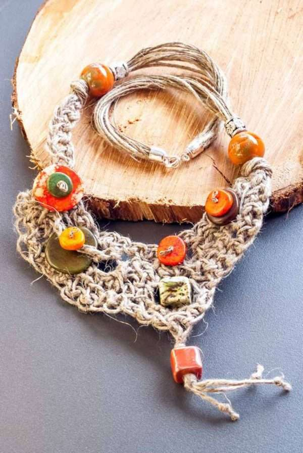 Asymmetrical Linen Necklace on the wood