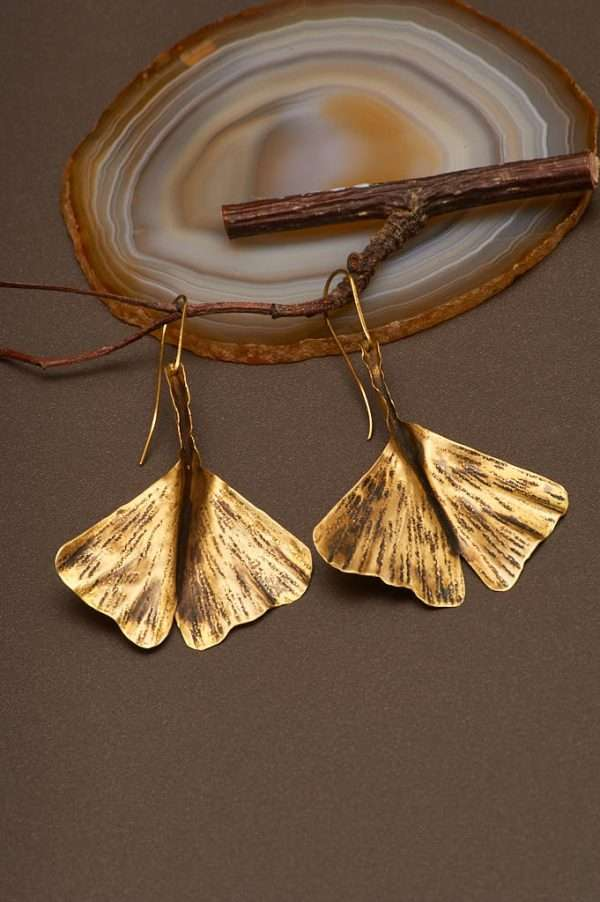 Ginkgo Fly Gold Earrings displayed on the nice background with branch and agate designed by Ertiusn