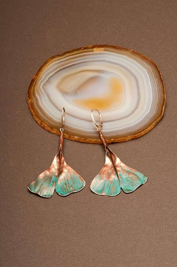 Ginkgo Green Earrings displayed on the agate stone with wood designed by Ertisun