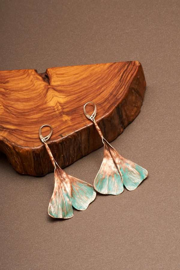 Ginkgo Green Earrings displayed on the with wood designed by Ertisun