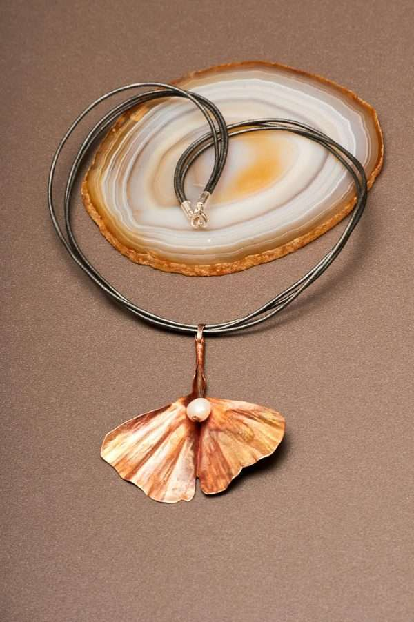 Ginkgo with Pearl Necklace displayed on the plain background with agate stone Ginkgo comes with natural pearl all designed by Ertisun