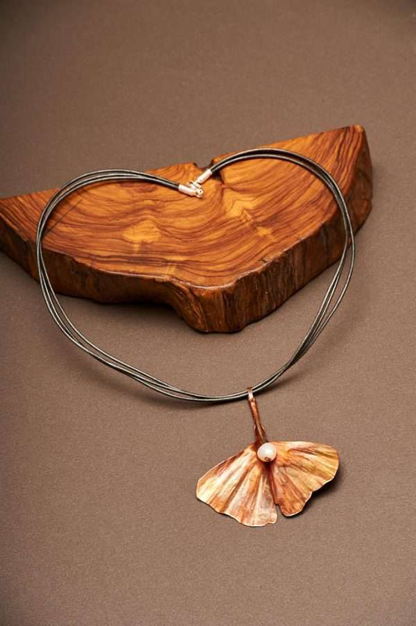 Ginkgo with Pearl Necklace displayed on the plain background with wood Ginkgo comes with natural pearl all designed by Ertisun