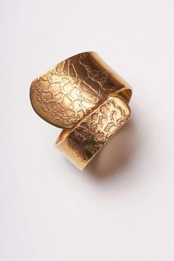 Handmade Adjustable Brass Ring top view distant shot