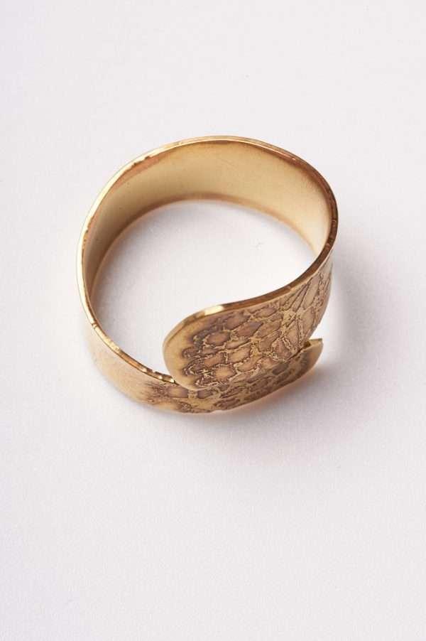 Handmade Adjustable Brass Ring on display