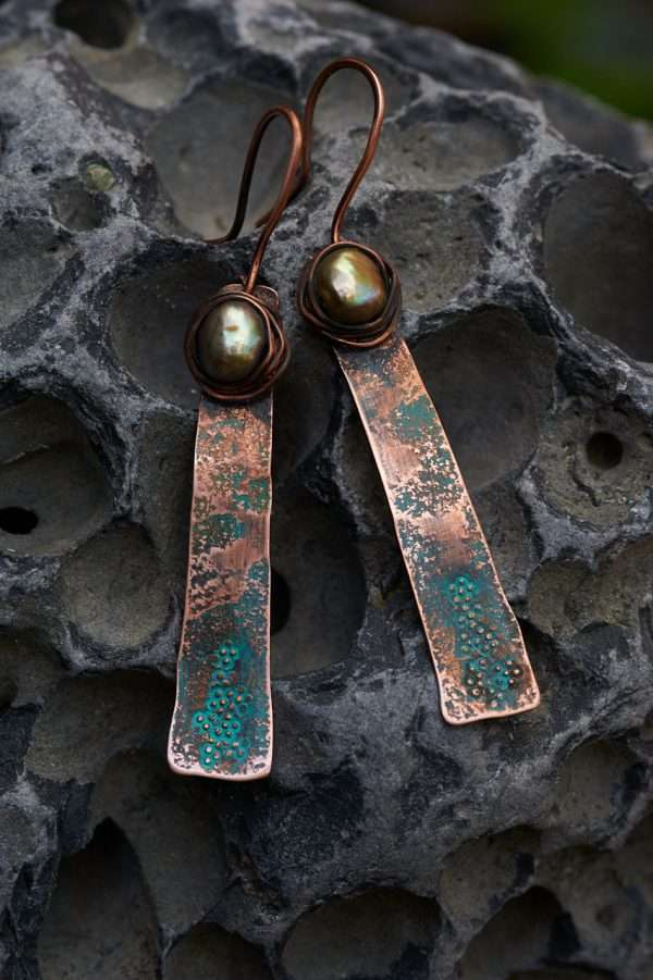Rustic Copper Earrings Placed on rock close shot