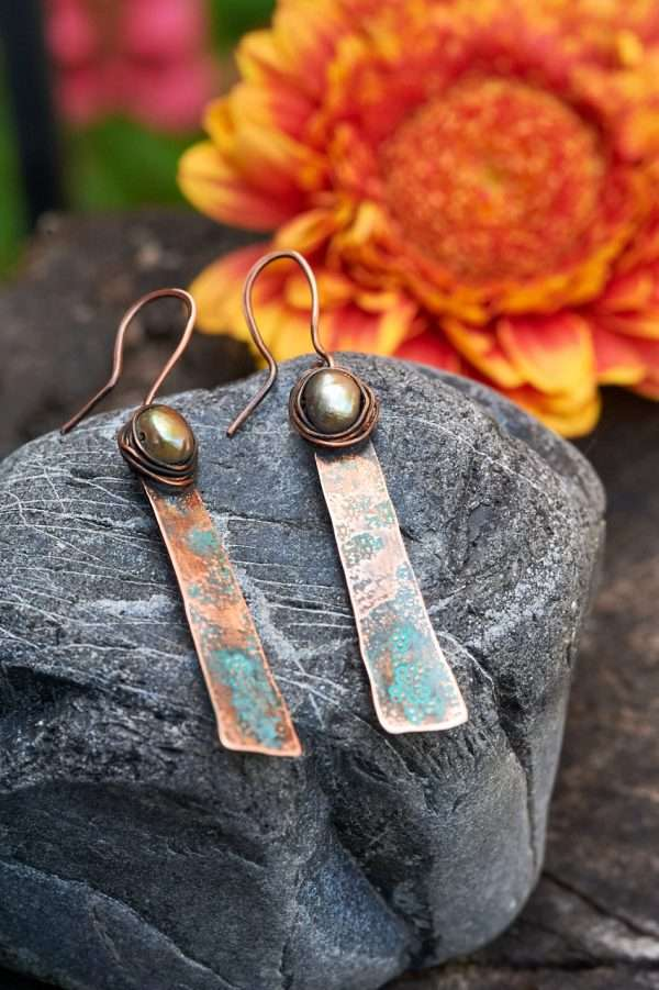 Rustic Copper Earrings Placed on rock front view