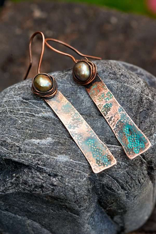 Rustic Copper Earrings Placed on rock side view