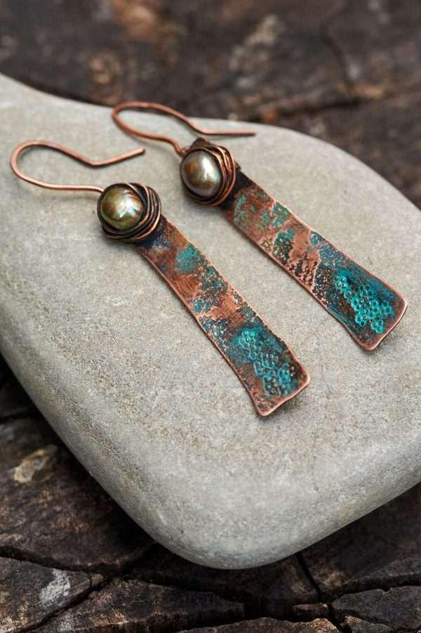 Rustic Copper Earrings Placed on rock