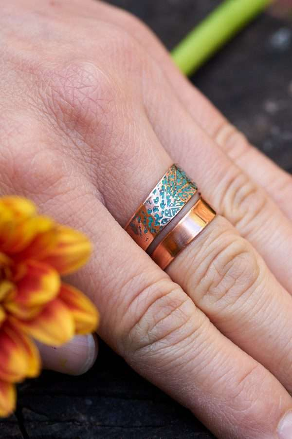 Woman wearing Copper Leaf Motif Ring on her finger close shot